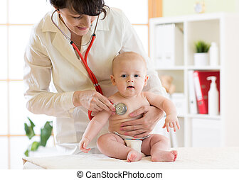 woman pediatrician examining of baby boy with stethoscope