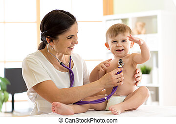 woman pediatrician examining of baby kid with stethoscope