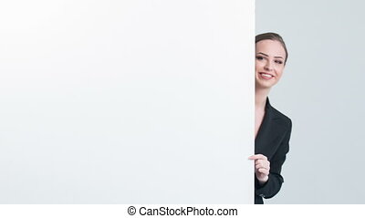 Woman peeking out and showing on white board - New...