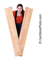 Woman peeking out from between two planks