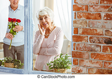 Woman peeping through the window