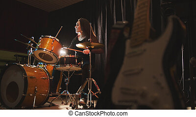 Woman percussion drummer performing with drums