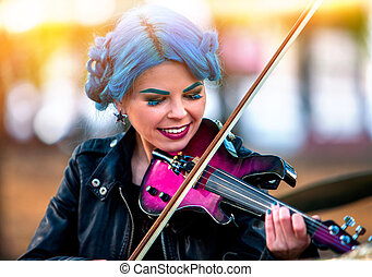 Woman perform music on violin park outdoor. Girl performing jazz .