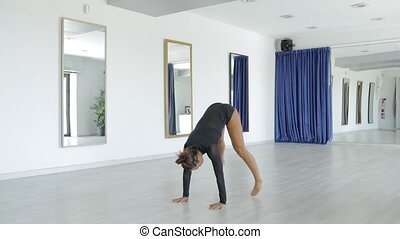 Woman performing gymnastics exercise - Young fit girl in...