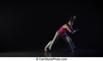 Woman performing incredibly complex of martial art of...