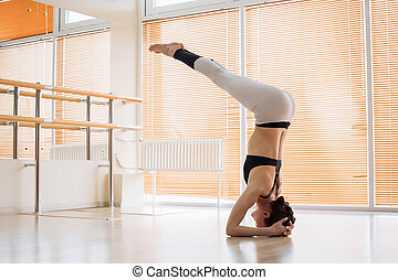 Woman performing yoga exercise on floor - Lovely young woman...