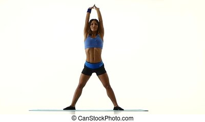 Woman performs a forward and backward tilt. White