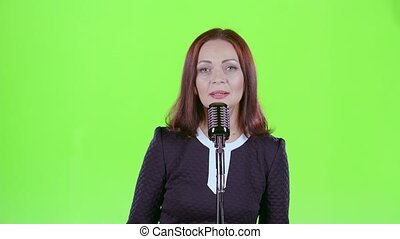 Woman performs her song of authorship. Green screen - Woman...