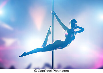 Woman performs sensual, passionate pole dance in night club....