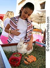 Woman petting a rabbit