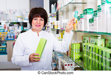 Woman pharmacist in pharmacy