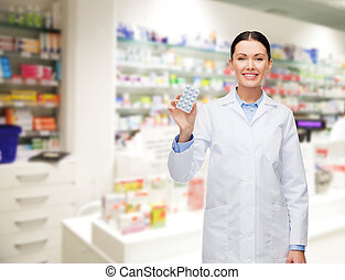 woman pharmacist with pills drugstore or pharmacy