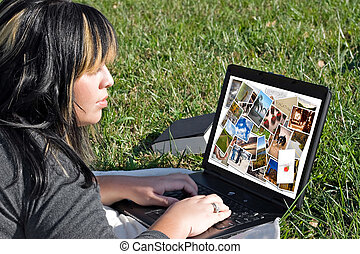 Woman Photo Editing - A young woman viewing or editing a...