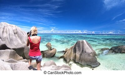 woman photographer at Seychelles - Back side of woman...