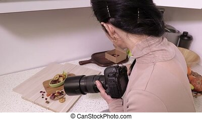 Woman photographer before food photographing