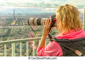 Woman photographer in Paris