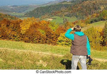 Woman photographer in the mountains.