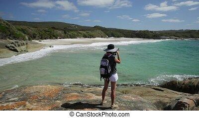 Woman photographer in Waterfall Beach Australia - Woman...