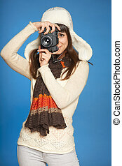 Woman photographer making picture of you