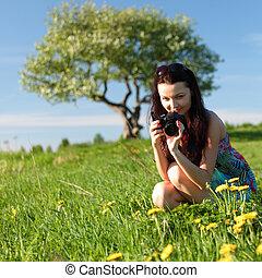 woman photographer on green grass field