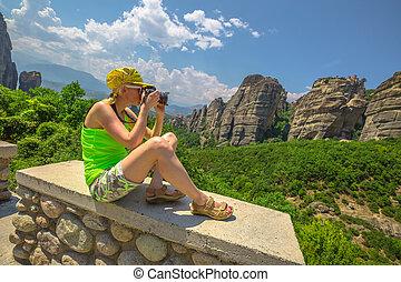 Woman photographer outdoors