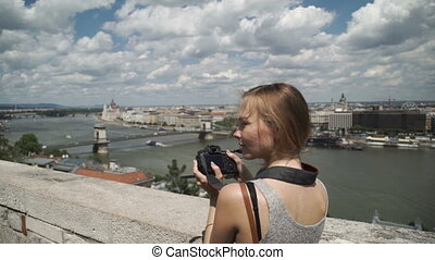 Woman photographer shooting view of the city tourist