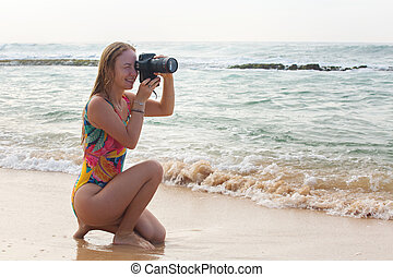 Woman-Photographer takes pictures
