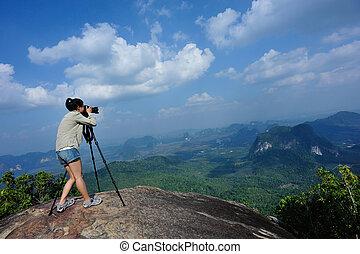 woman photographer taking photo