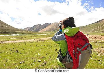 woman photographer taking photo - woman photographer taking...