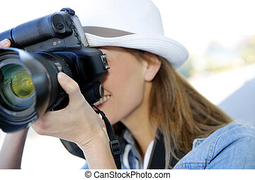 Woman photographer taking professional pictures