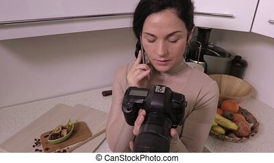 Woman photographer talking on smartphone