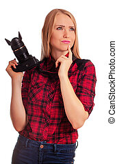 Woman photographer thinking what to shoot - isolated on white