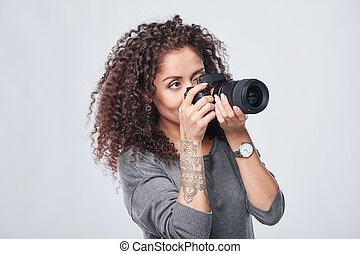 Woman photographer with professional photo camera