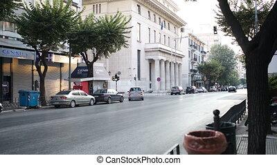 Woman photographing an urban street
