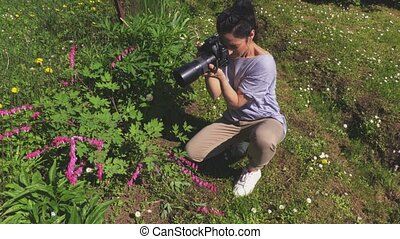 Woman photographing flowers at outdoor