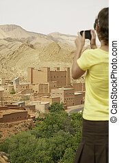 Woman Photographing Ruins