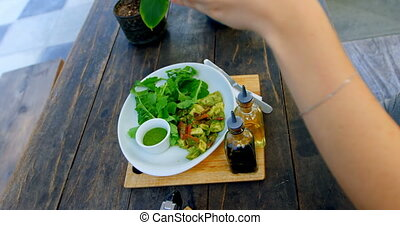Woman photographing salad on the table 4k - Woman ...