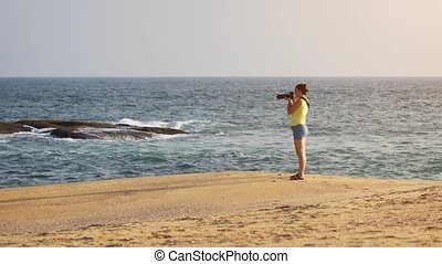 Woman Photographing Sri Lankan Oceanscape from Sandy Beach -...