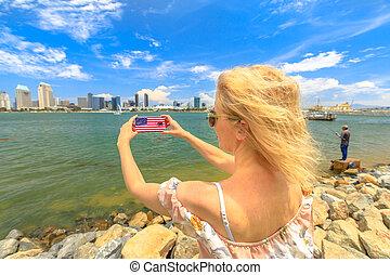 Woman photographs San Diego