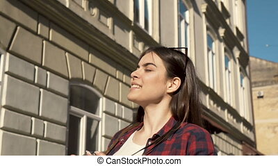 Woman Photographs with Camera - Pretty young woman...
