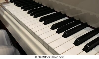 Woman pianist hands plays gentle classical music on a ...
