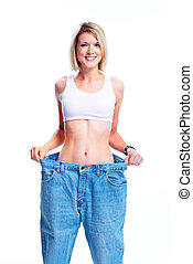 Woman. - Happy young woman with big jeans. Weight loose....