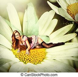 woman pixie lies on a daisy flower