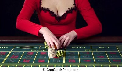 Woman placing an all in bet in roulette. Black - Woman...