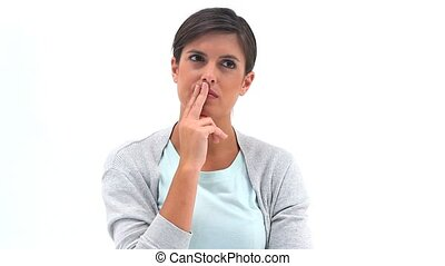 Woman placing her fingers on her mouth