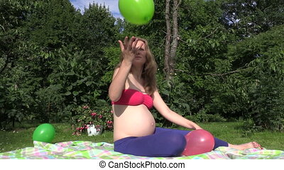 woman play balloon - Smiling pregnant woman girl play with...