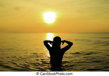 Woman play water in the sea