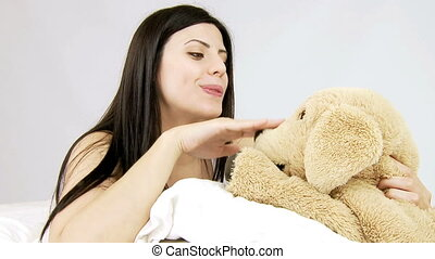Woman play with stuffed animals