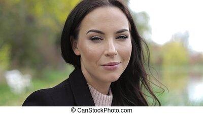 Woman playfully looking at camera - Beautiful woman in black...