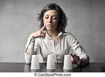 Woman playing a game - Woman playing cup game